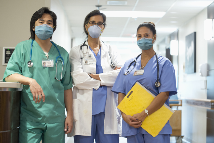 3 Healthcare Professionals Hallway_wearing masks_small