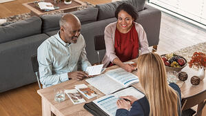 African American Couple_financial planner agent meeting_small