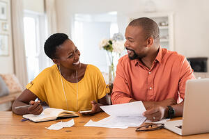 African American couple review finances_small