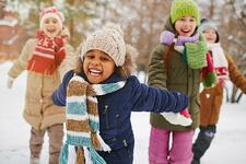 Diverse kids playing in snow smiling_small