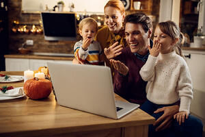 Family celebrating virtual holiday_small