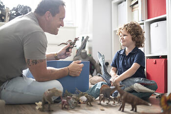 Father son playing with animals