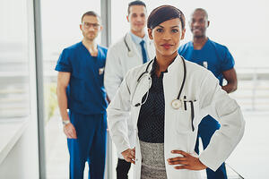 Female Physician Leader in powerful stance_small-2
