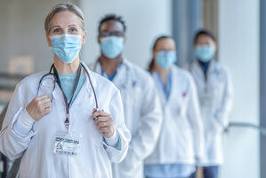 Female physician_blurred physicians background_masks_small