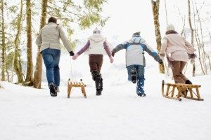 Family pulling sled
