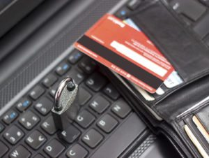 Identity Theft Credit card with wallet on computer