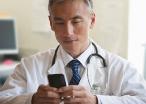 Doctor using Technology and Cell Phone