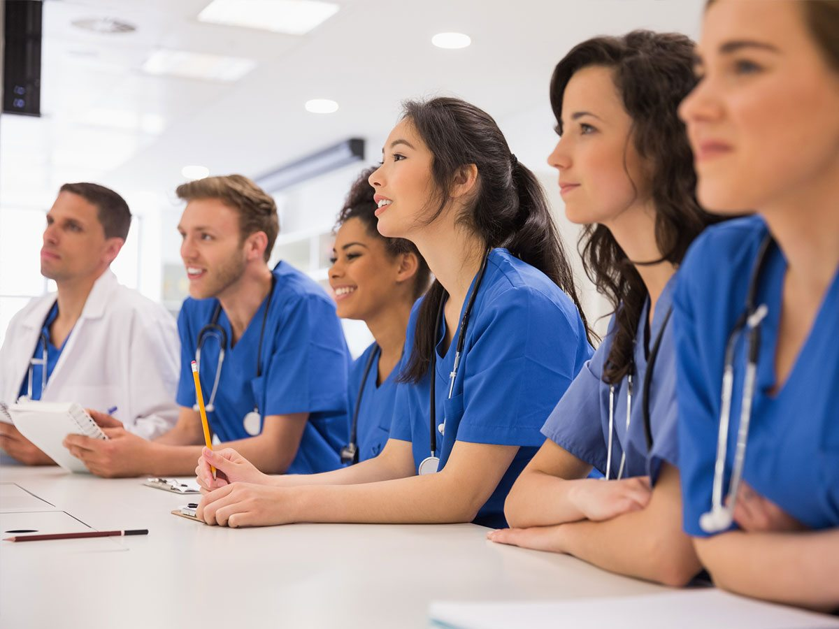 group of young doctors physcian well being programs