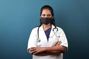 Indian female doctor smiling-mask on_small