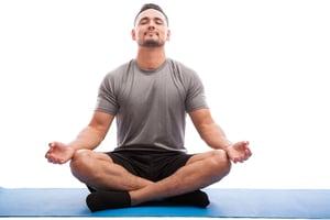 Male athlete meditating
