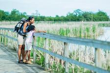 Mom and Daughter on Walk on bridge in marsh_small