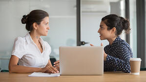 Two woman talking in an office_small