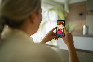 Woman_FaceTime with older parents
