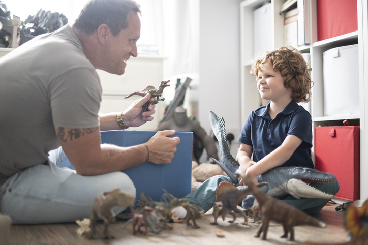 father-playing-dinosaurs-with-child