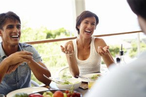 two-people-laughing-at-dinner