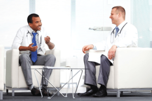 Two doctors sitting and talking