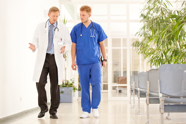 Old & Young Male Physicians Walking_Advocate_Small