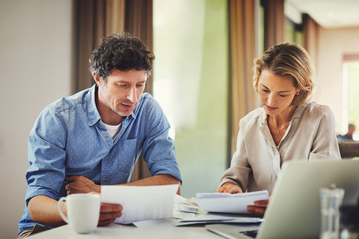Couple reviewing financial statements